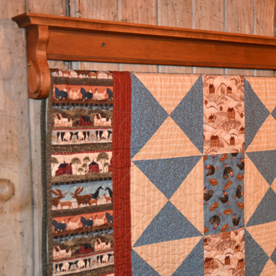 Hanging quilt shelf crafted by DWR Custom Woodworking